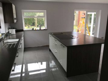 Zola Kitchen with Grey and Brown Aola Cabinets